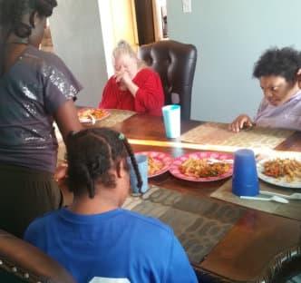 a caregiver serving an elder woman