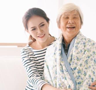 a woman hugging an elder woman