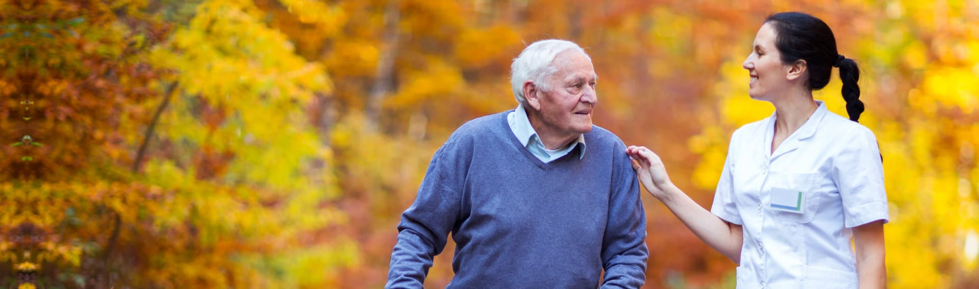portrait of a man and a caregiver walking